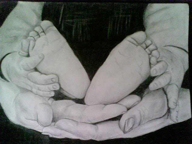 Mom hands and James' feet