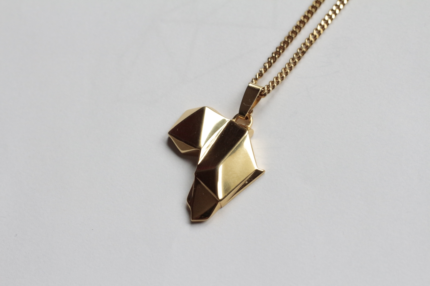 golden.Roots (low-poly Africa pendant)