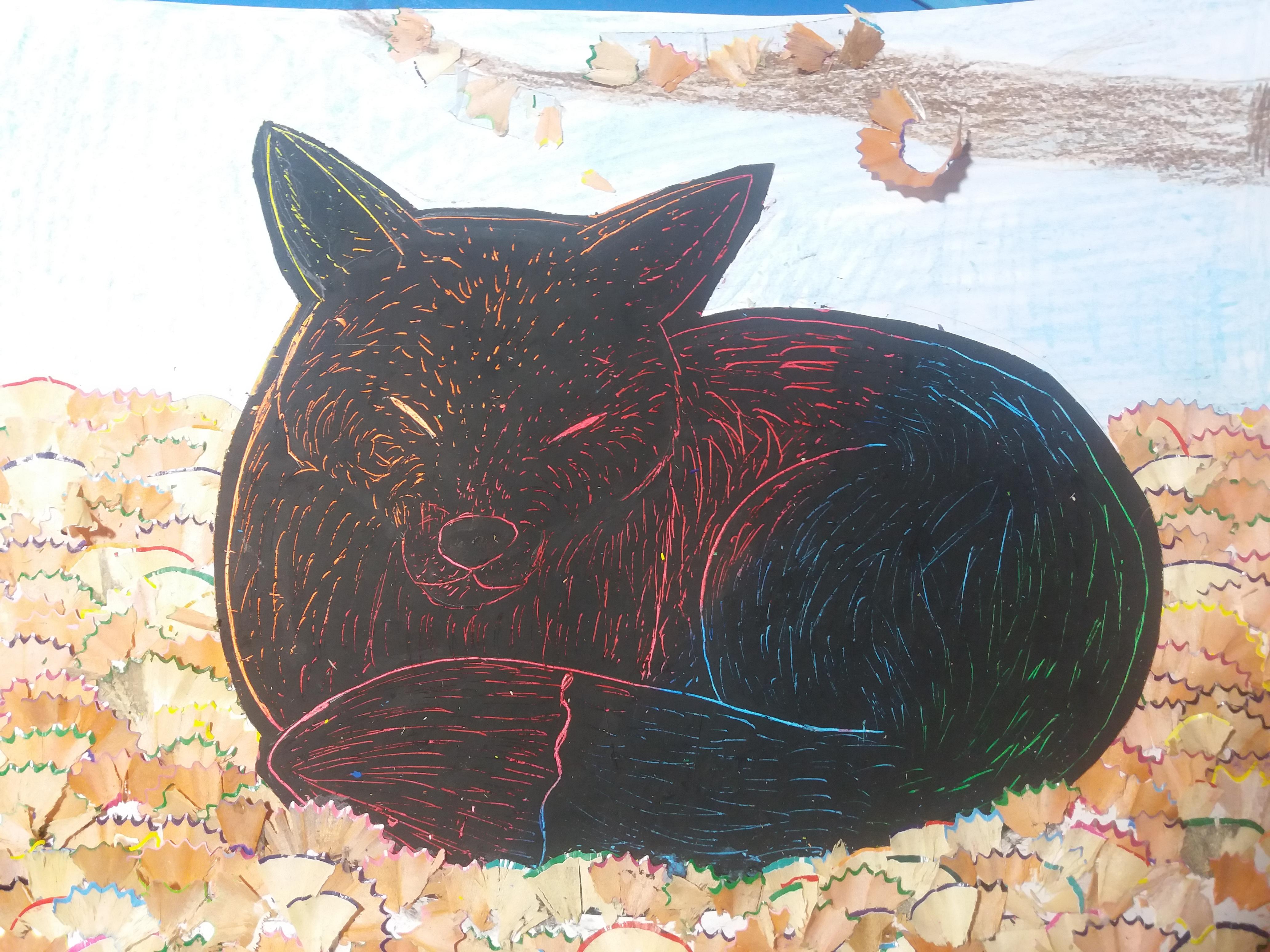 Fox in autumn leaves
