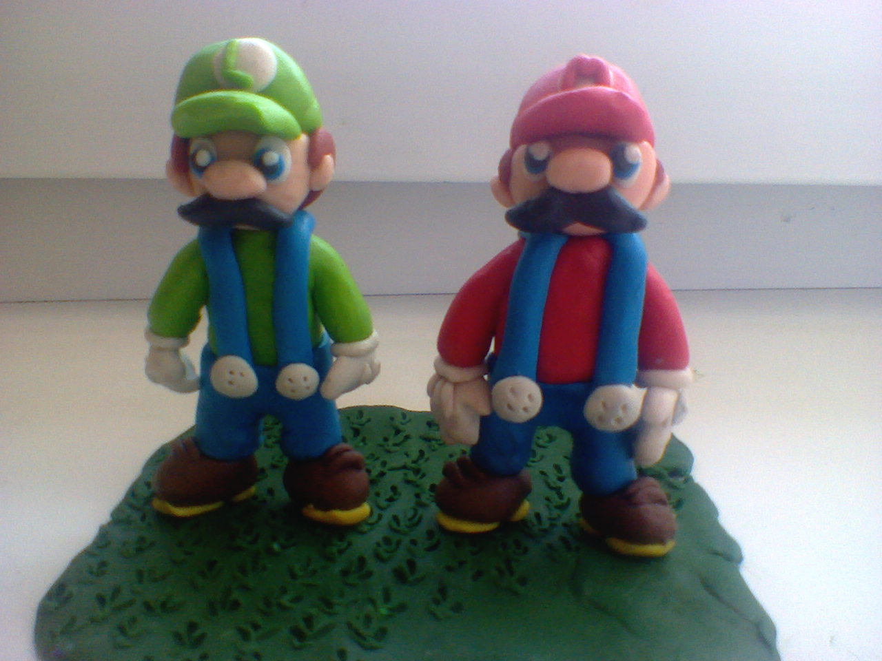 Mario & Luigi in grass