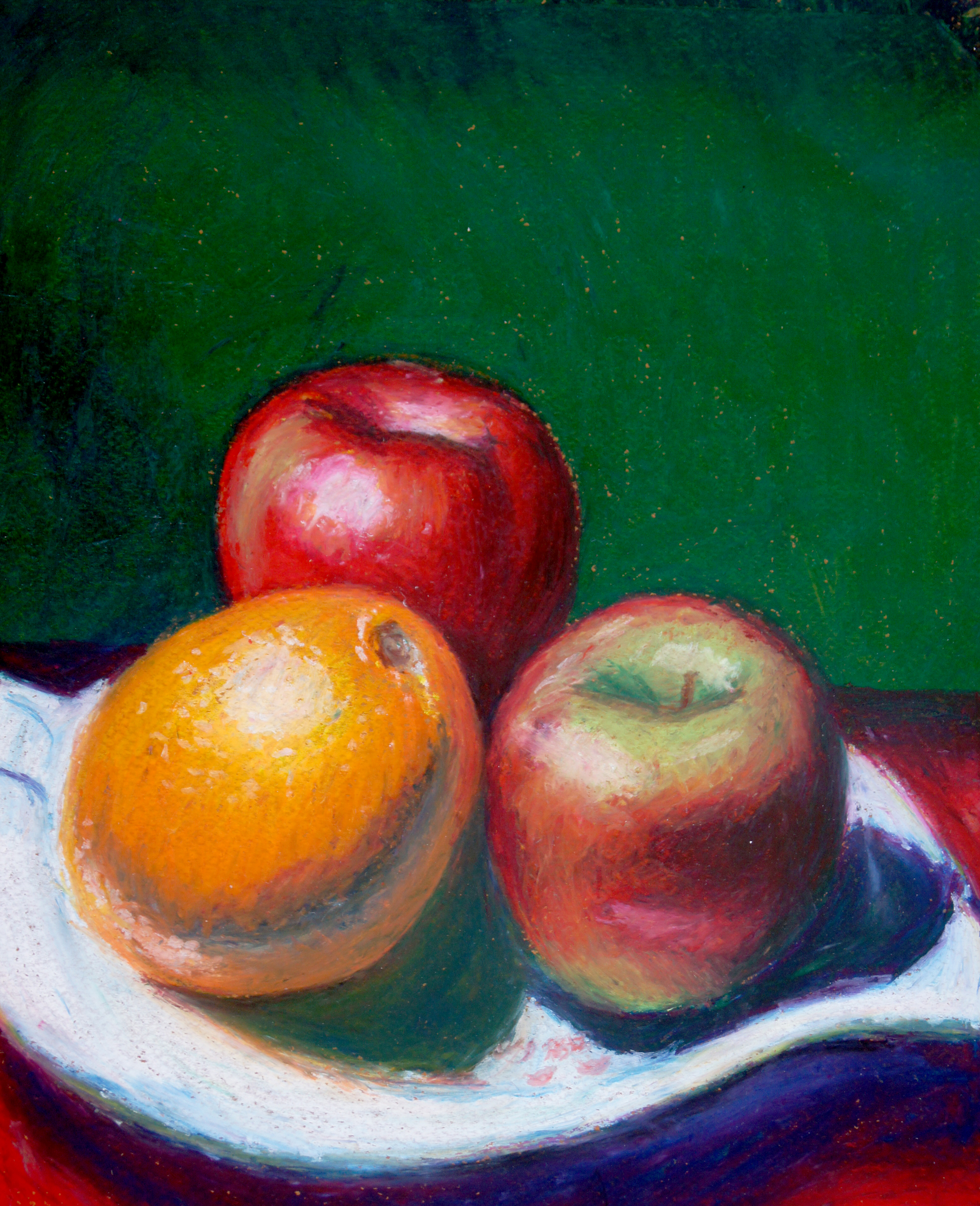 Still life with apples and an orange on a plate