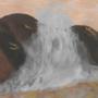 Crashing waves on rocks at sunset