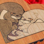 Heart shaped box with loving otters