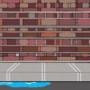 A sidewalk and brick wall.