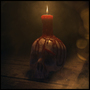 Dirty skull with candle